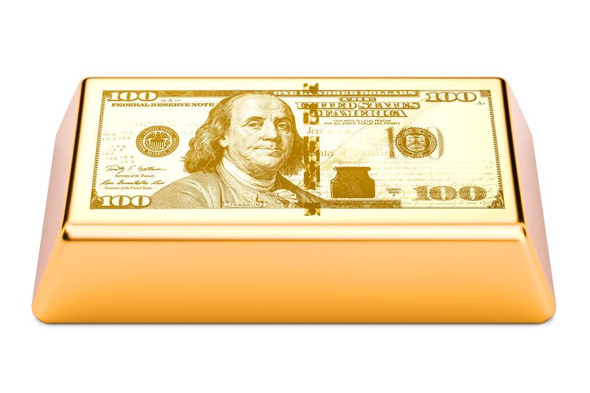 Lingote de oro con imagen de un billete de dólar