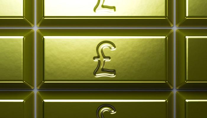 Lingotes de oro con el símbolo de la libra esterlina